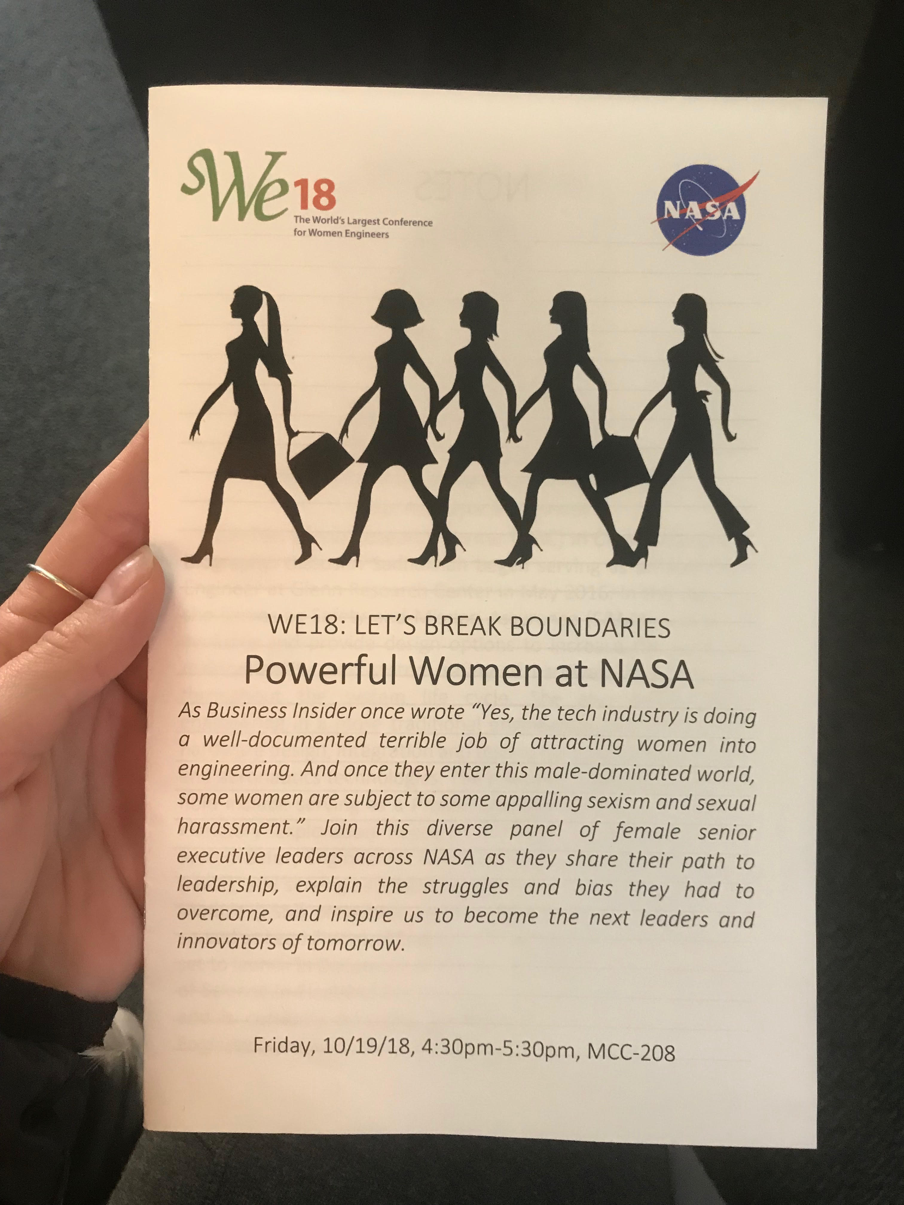 "A photo of a pamphlet that reads: ""WE18: LET'S BREAK BOUNDARIES. Powerful Women at NASA"" with a further description of the talk below."