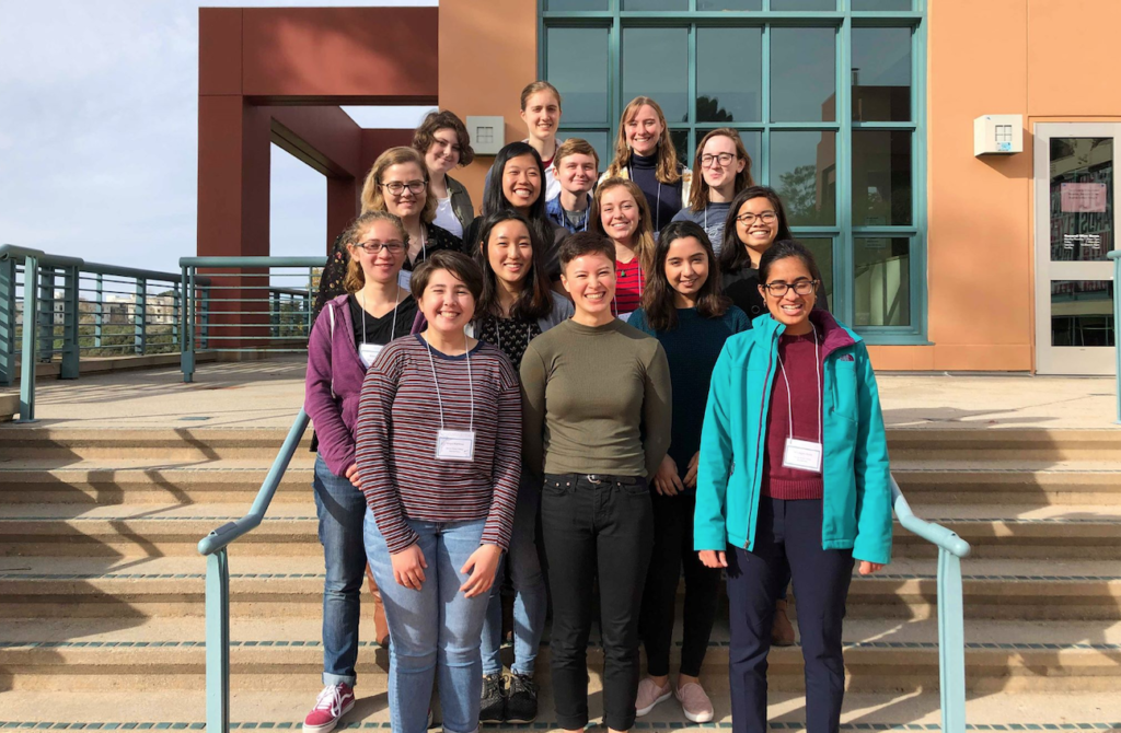 15 of the women physics majors stand and smile together at CUWiP