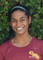 Picture of Aarthi wearing a red shirt that says CMS Soccer in gold letters blow a grey Nike checkmark. She is smiling and wearing a grey headband.