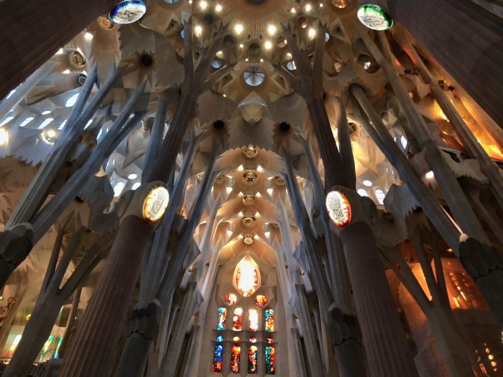 stained glass, columns, and ceiling inside the Sagrada Familia