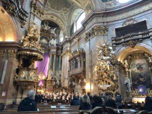 a choir singing in a chapel