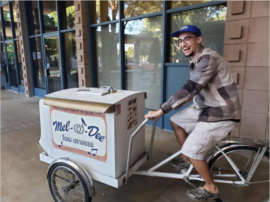 Joaquin, happily riding the ice cream bike