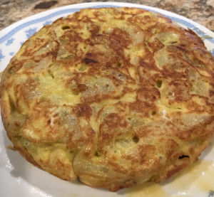 plate with egg omelette with potatoes