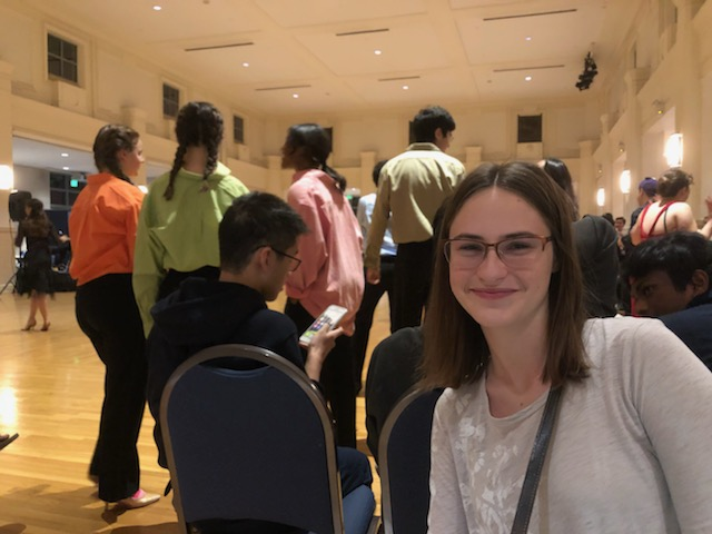 Hannah in front of a group of dancers