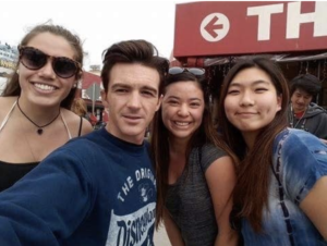 Kira and two other college friends pose for a selfie with actor Drake Bell.