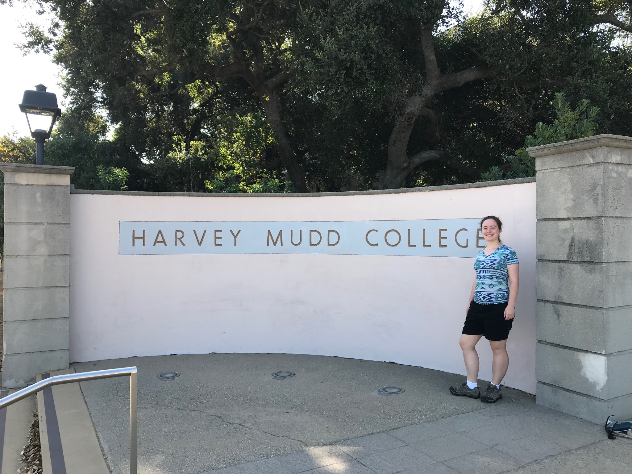 Malia in front of a Harvey Mudd College