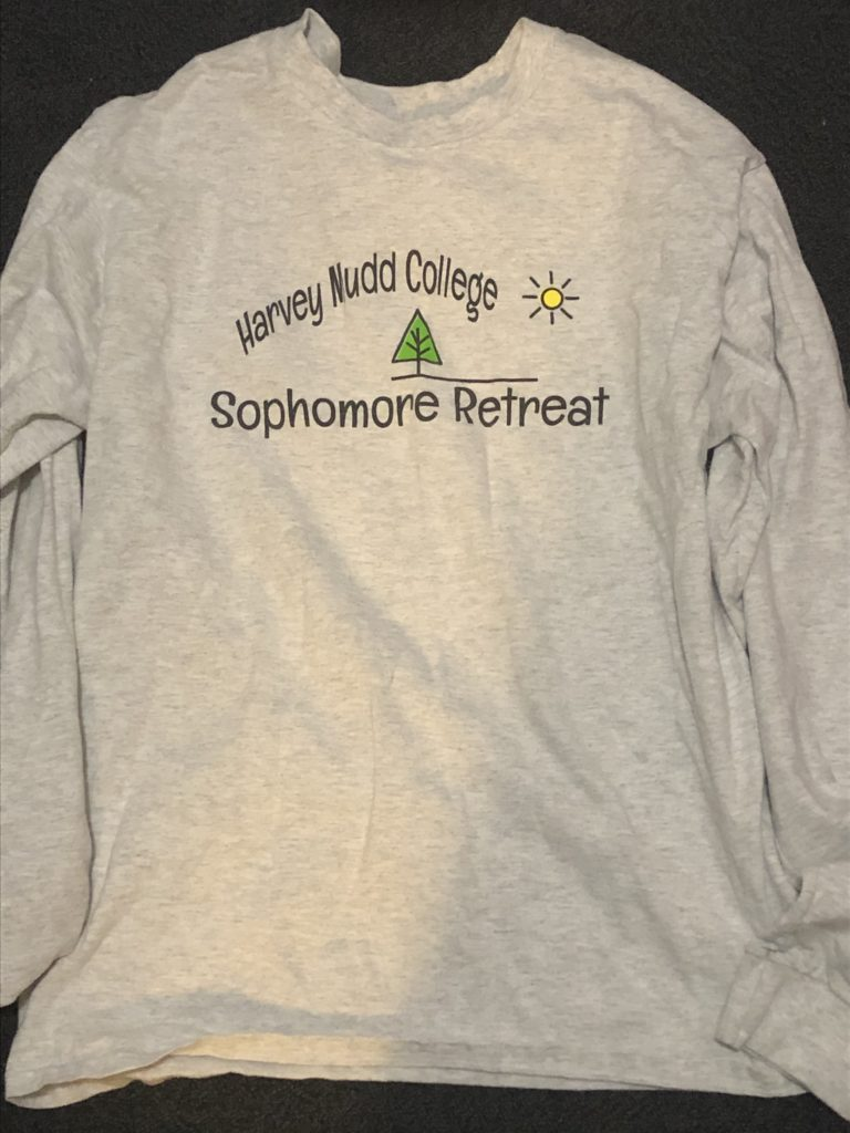 """White long sleeve T-shirt with words """"Harvey Mudd College Sophomore Retreat"""" and a cartoon pine tree."""