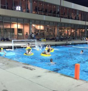 Students playing inner-tube water polo
