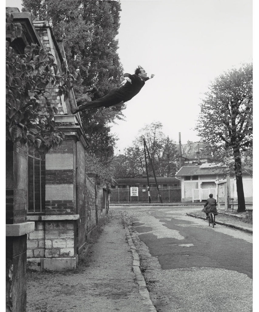 Image of man leaping off of a roof