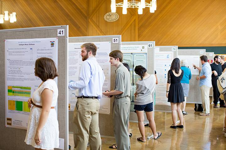 HMC student researchers reviewing project posters