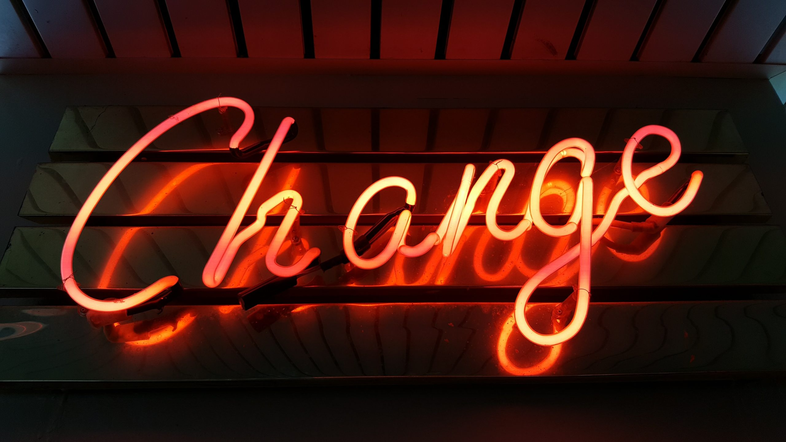"neon sign reading ""change"" Photo by Ross Findon on Unsplash"