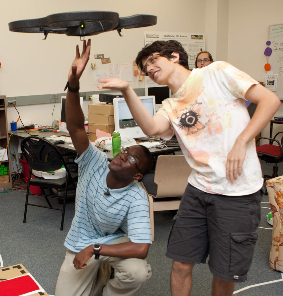 Students inspect a quadcopter.