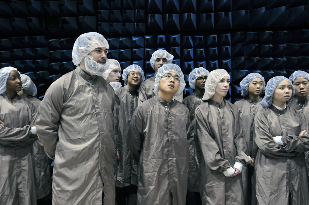 HMC students dressed in clean room gear on tour at SSL