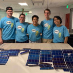 students with solar panels