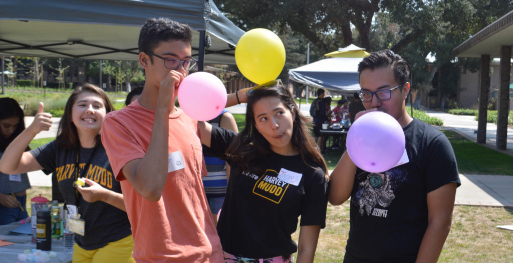 Students play with balloons.