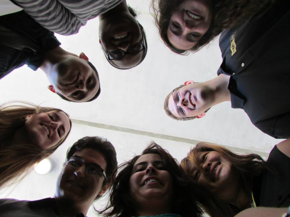 Summer Institute participates in a circle looking down at camera
