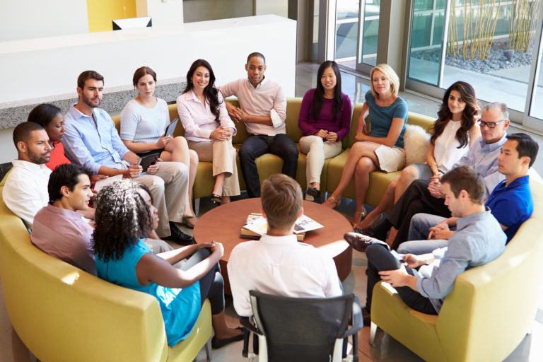 Picture of a group of people sitting in a circle and talking