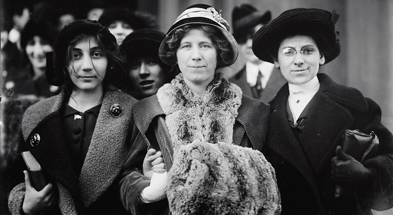 """Photograph shows suffrage and labor activist Flora Dodge """"Fola"""" La Follette, social reformer and missionary Rose Livingston, and a young striker during a garment strike in New York City in 1913. (Image source: Library of Congress Prints, Photographs Division)"""