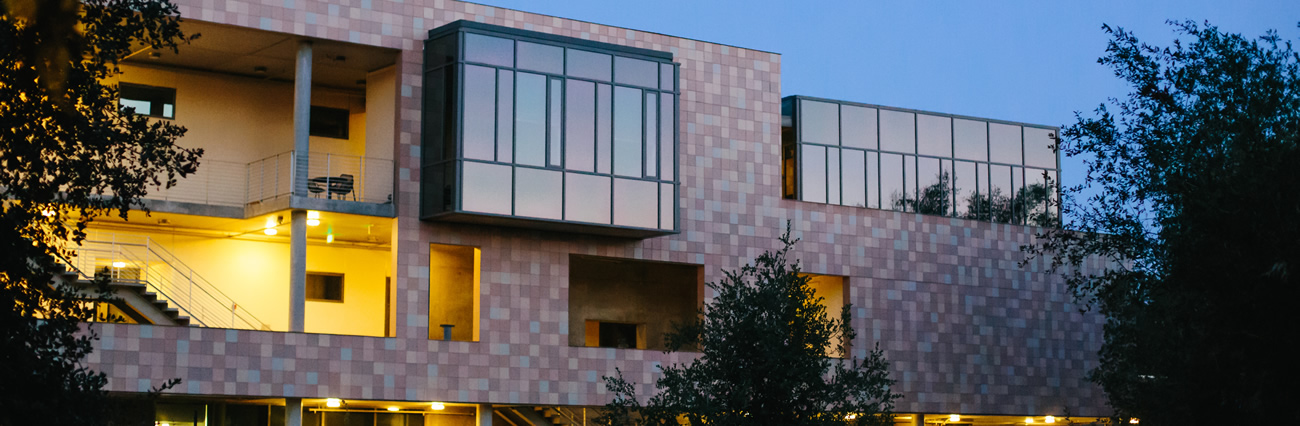 West face of Shanahan Center at dusk.