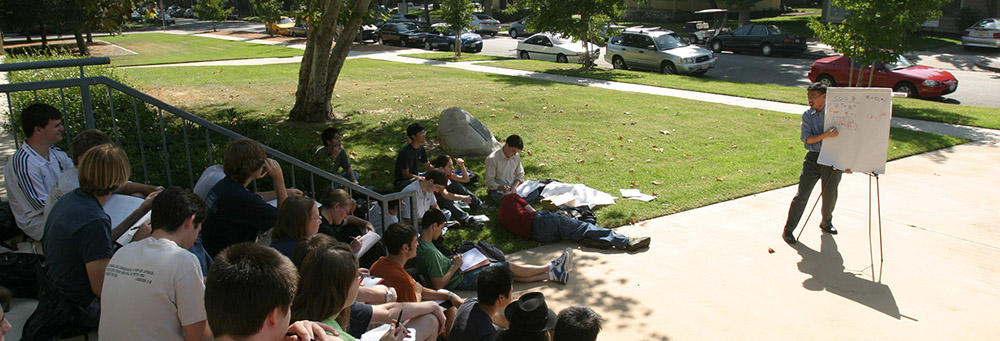 Professor Yong outside with students
