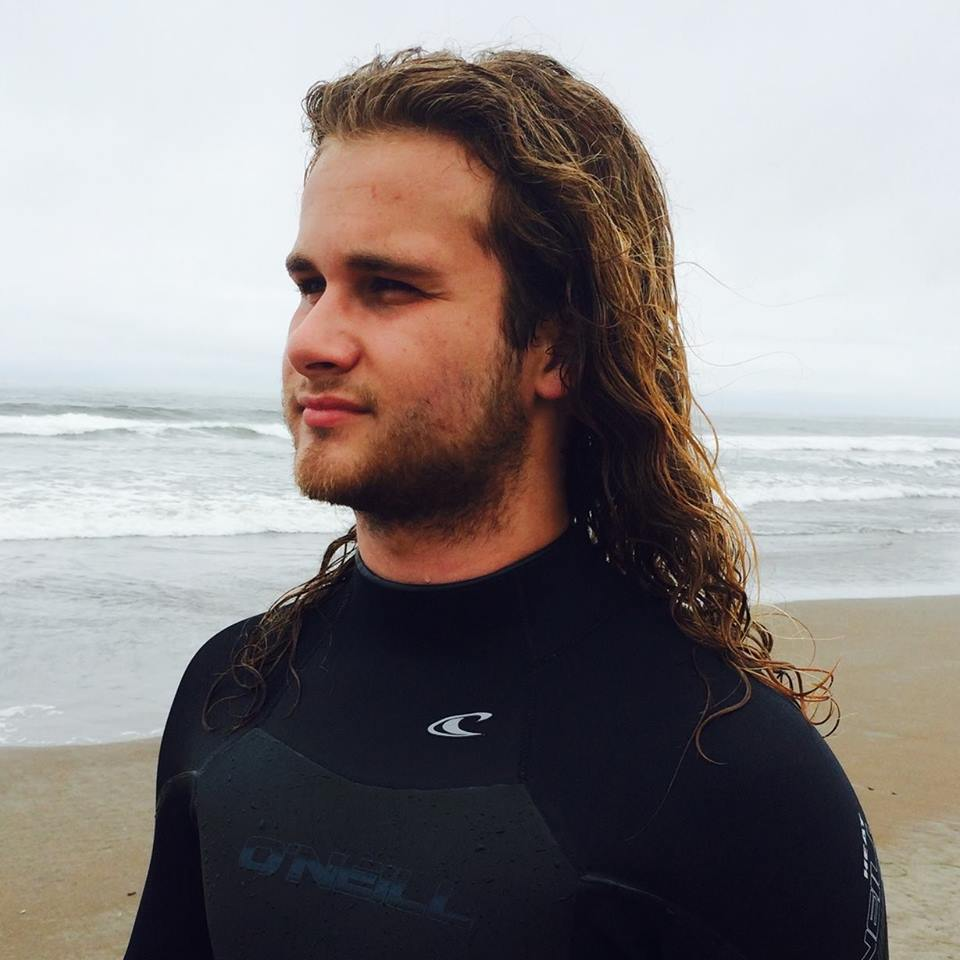 Tristan Witte in wetsuit at beach.