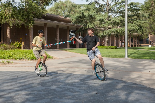 Students joust on unicycles.