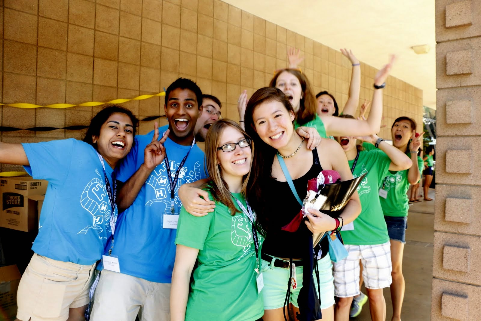 Orientation students smiling and waving.