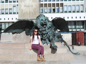 Marianna Sbordone in front of winged lion statue.