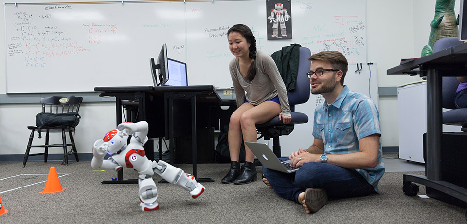Prof. Boerkoel and student with robot