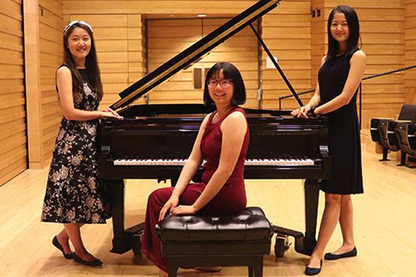 Haoxing Du, Nora Hu and Maggie Li in Drinkward Recital Hall at Harvey Mudd College