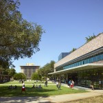 Students walk on the Harvey Mudd College campus near the Shanahan Center with Sprague Center in the background