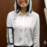 Student wearing West Wave device