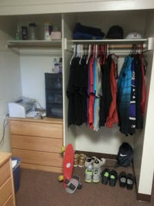 My closet, complete with my wardrobe of Giorgio Armani, Ralph Lauren, and J. Crew. By that I mean free t-shirts I have received from various events at Mudd and my thrift store dress clothing.